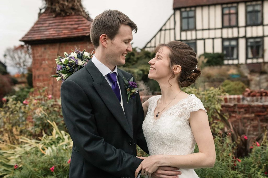 Bride and Groom in front of Alswick Hall at Alswick Barn wedding in Buntingford, taken by Becky Harley Photography