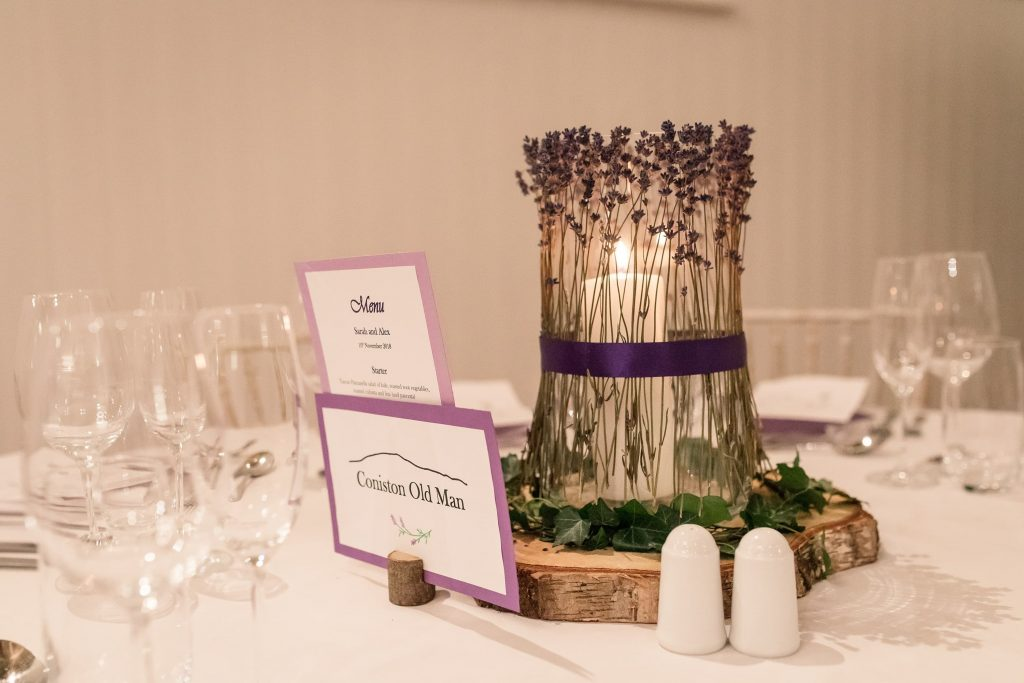 Table setting with candles and lavender at Alswick Barn wedding in Buntingford, taken by Becky Harley Photography