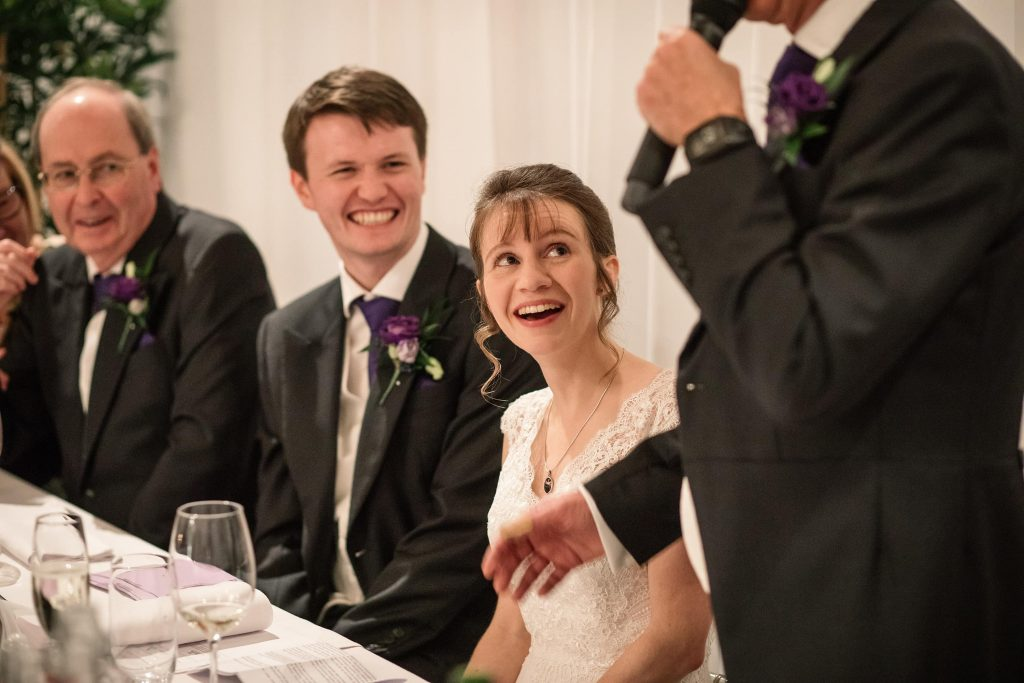 Bride and Groom speech reactions at Alswick Barn wedding in Buntingford, taken by Becky Harley Photography