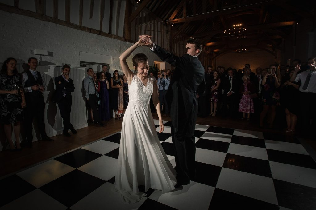 Bride and Groom twirling on dancefloor at Alswick Barn wedding in Buntingford, taken by Becky Harley Photography