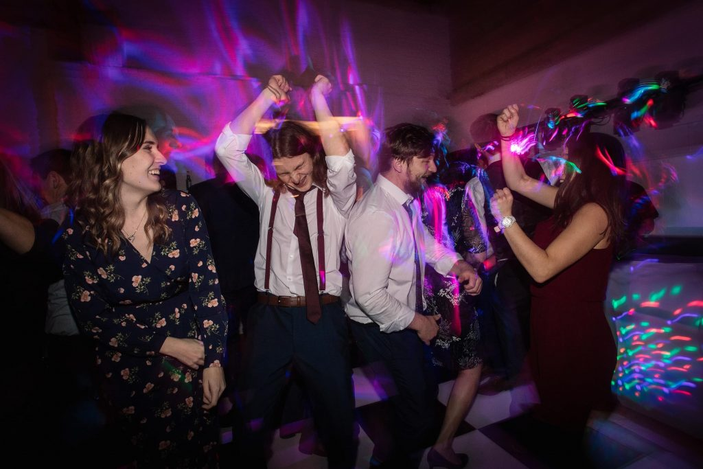 Guests dancing at Alswick Barn wedding in Buntingford, taken by Becky Harley Photography