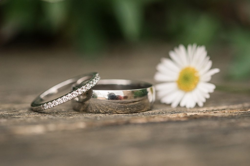 Wedding rings in springtime taken by Becky Harley Photography