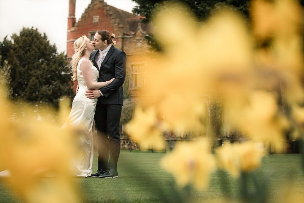 Bride and Groom among Daffodils taken by Becky Harley Photography