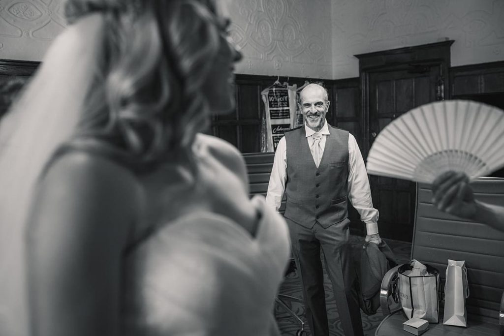 Father of the bride seeing daughter in wedding dress at summer Fanhams Hall Wedding taken by Becky Harley Photography