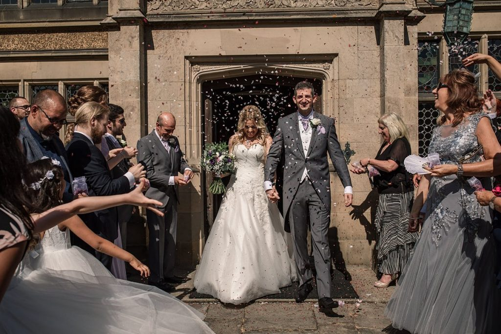 Bride and groom with confetti throw at summer Fanhams Hall Wedding taken by Becky Harley Photography