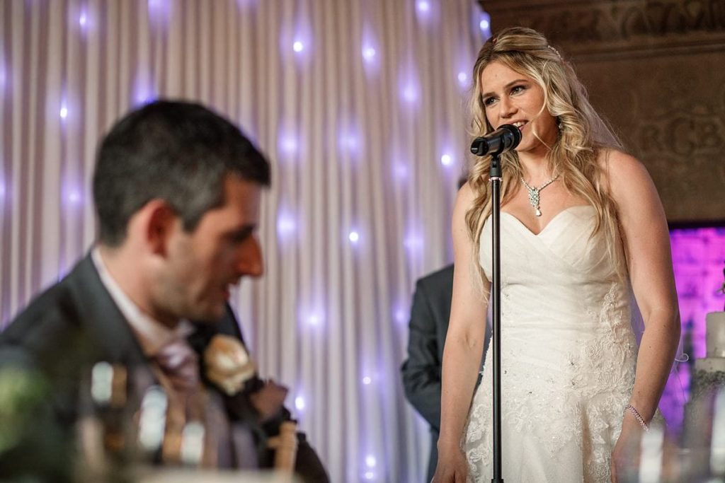 Bride giving speech at summer Fanhams Hall Wedding taken by Becky Harley Photography