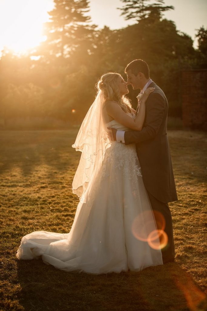 Bride and Groom in evening sun at summer Fanhams Hall Wedding taken by Becky Harley Photography