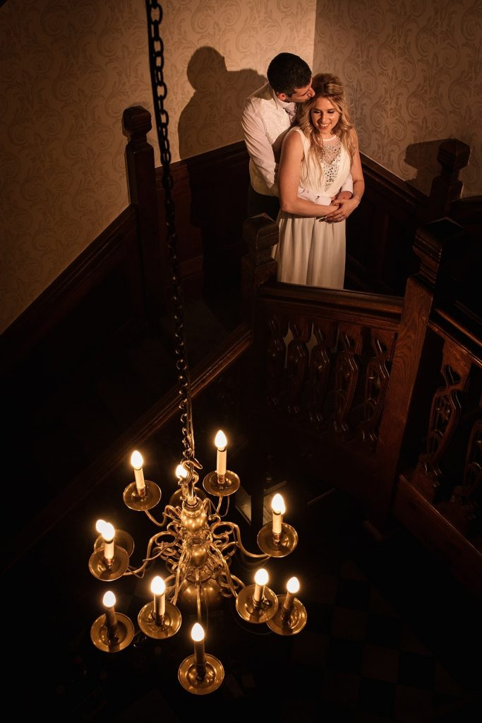 Bride and Groom on staircase at summer Fanhams Hall Wedding taken by Becky Harley Photography