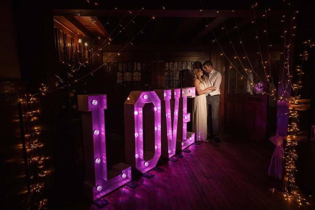 Bride and Groom with Love letters at summer Fanhams Hall Wedding taken by Becky Harley Photography