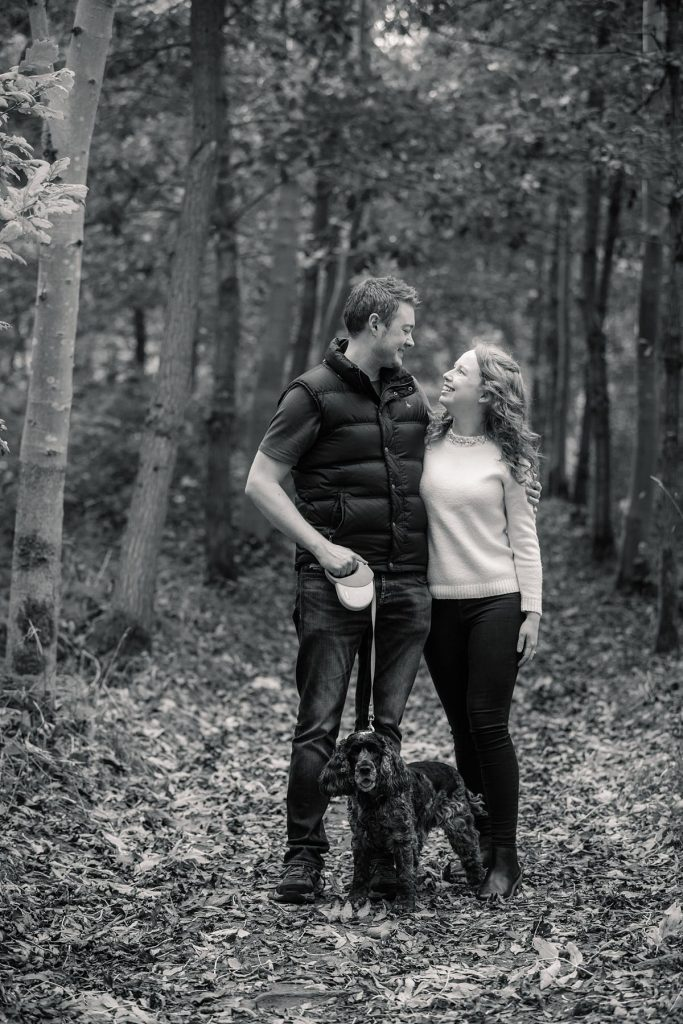 black and white photo of couple and dog in Hatfield House engagement shoot taken by Becky Harley Photography