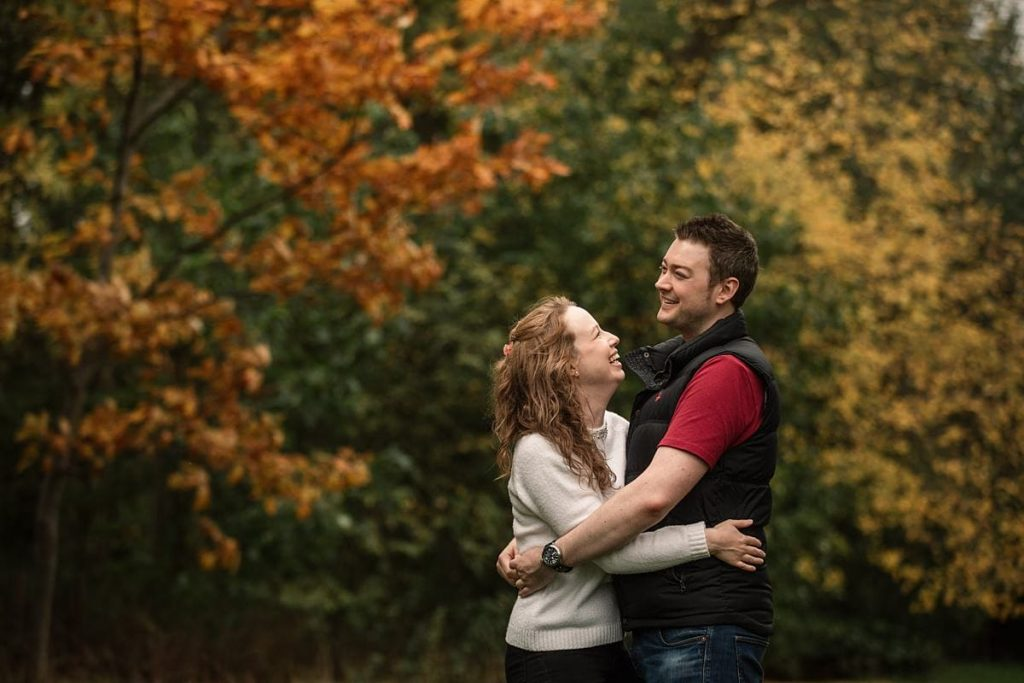 couple and autumn leaves at Hatfield House taken by Becky Harley Photography