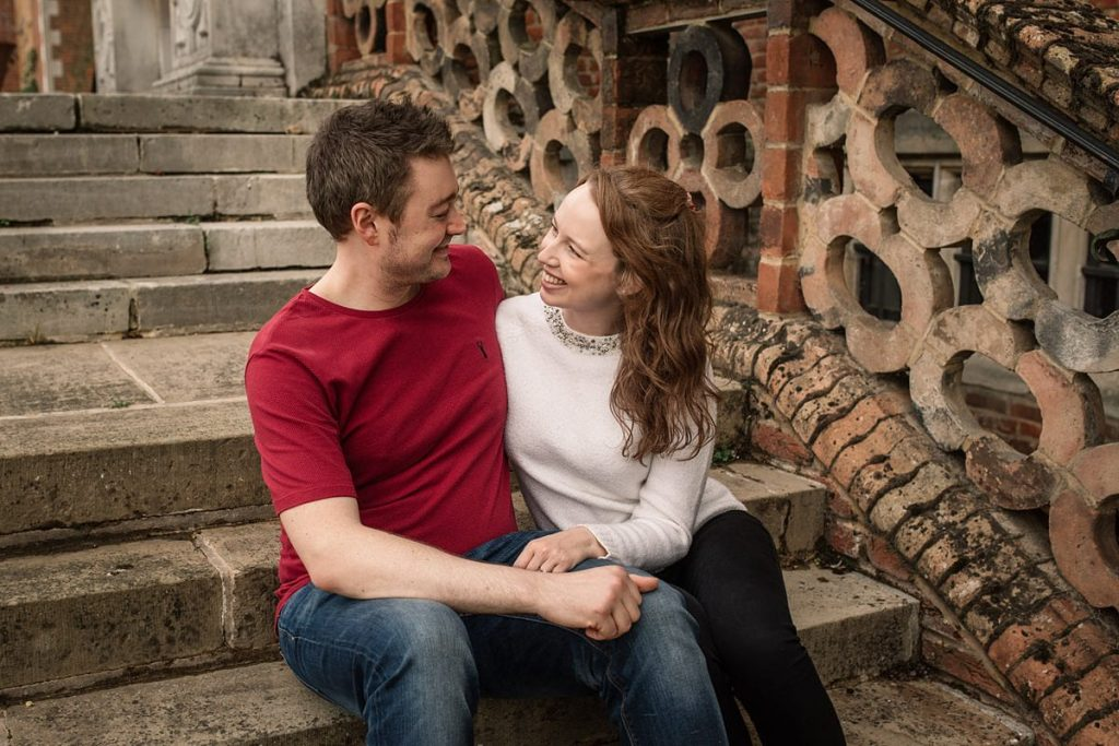 Couple on steps of Hatfield House taken by Becky Harley Photography
