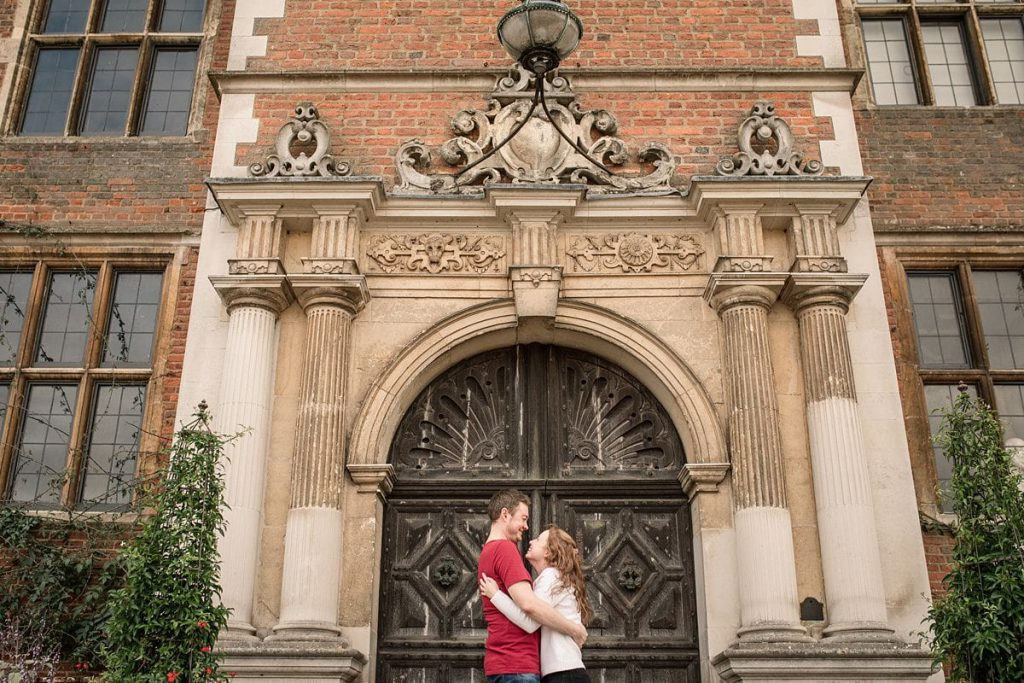 Couple by door to Hatfield House taken by Becky Harley Photography