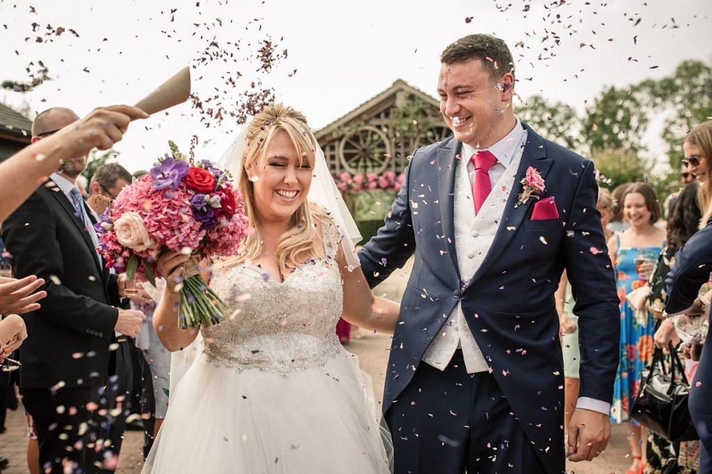 Confetti throw at Maiden's Barn in Essex taken by Becky Harley Photography