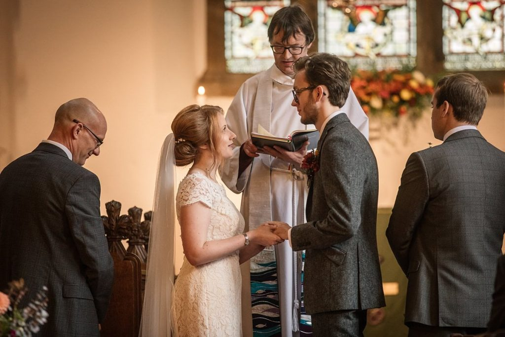Bride and Groom exchanging vows in church at Dodmoor House Wedding, taken by Becky Harley Photography