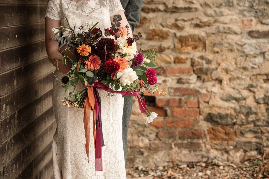 Bride with flowers by Bare Blooms at Dodmoor House Wedding, taken by Becky Harley Photography