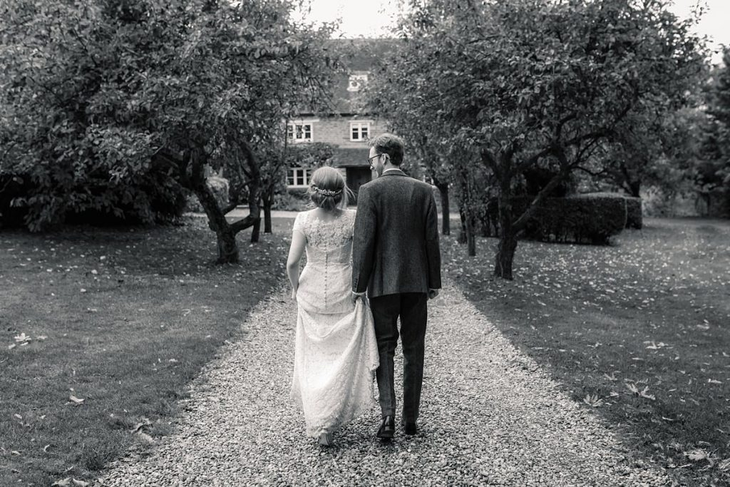 Bride and groom walking at Dodmoor House Wedding, taken by Becky Harley Photography
