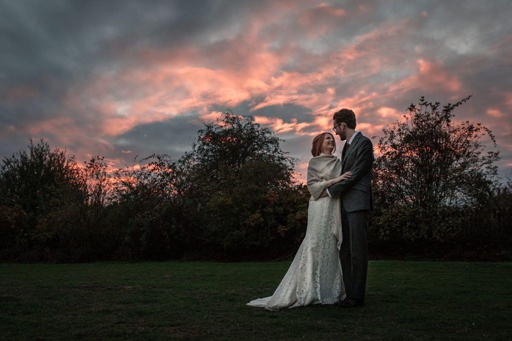 Bride and Groom with sunset sky at Dodmoor House Wedding, taken by Becky Harley Photography