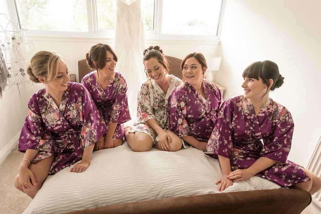 Bride and bridesmaids getting ready before Offley Place Wedding, taken by Becky Harley Photography