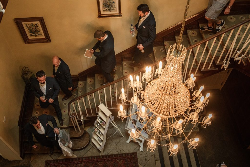 Groom and groomsmen on staircase at Offley Place Wedding, taken by Becky Harley Photography
