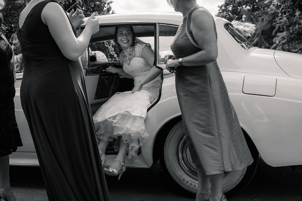 Bride arriving in wedding car at Offley Place Wedding, taken by Becky Harley Photography