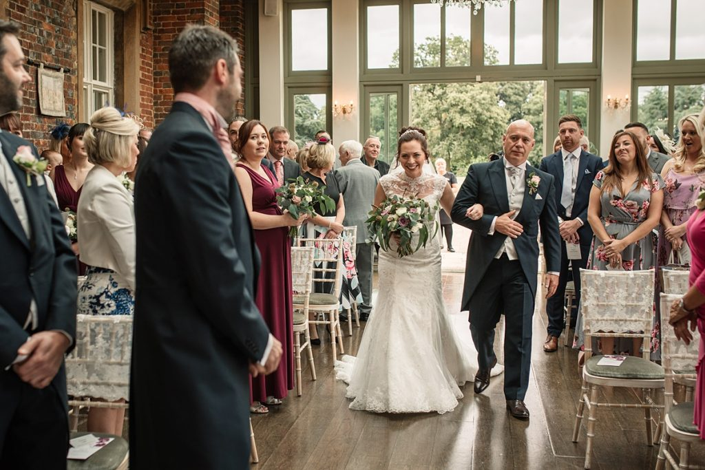 Bride walking down the aisle at Offley Place Wedding, taken by Becky Harley Photography