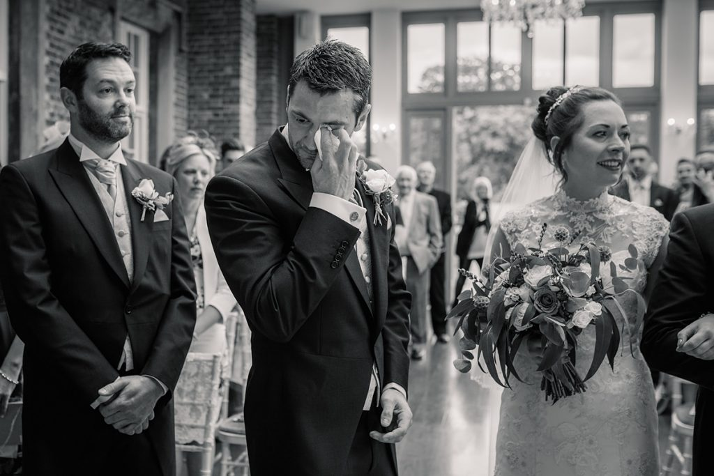 Groom wiping away a tear at Offley Place Wedding, taken by Becky Harley Photography