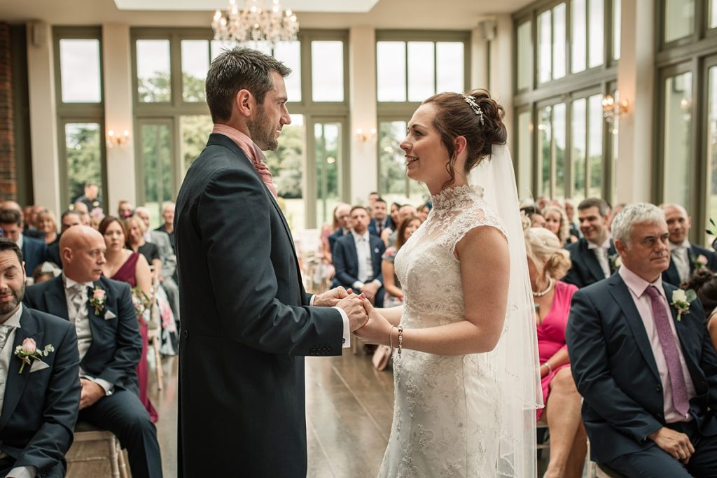 Bride and groom holding hands at Offley Place Wedding, taken by Becky Harley Photography