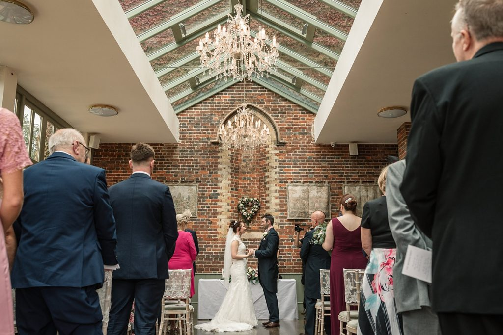 Bride and groom in the conservatory at Offley Place Wedding, taken by Becky Harley Photography