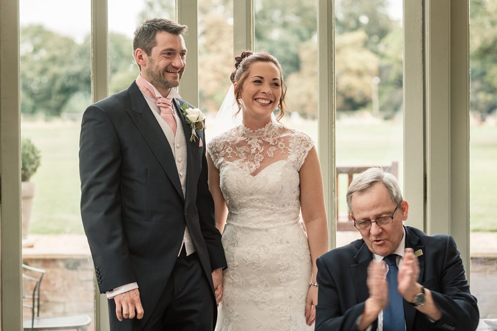 Bride and groom smiling at Offley Place Wedding, taken by Becky Harley Photography