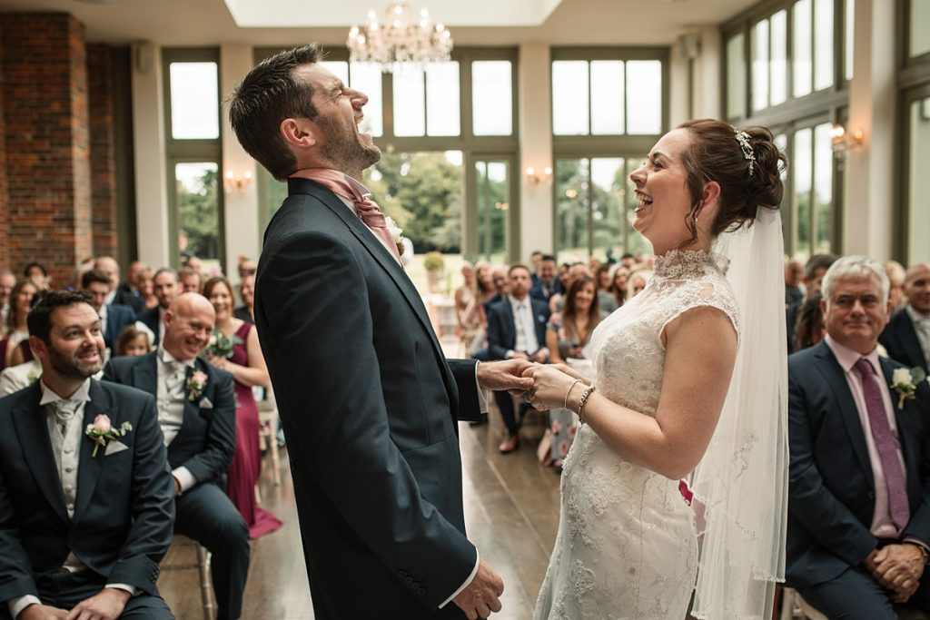 bride and groom laughing during wedding ceremony at Offley Place Wedding, taken by Becky Harley Photography