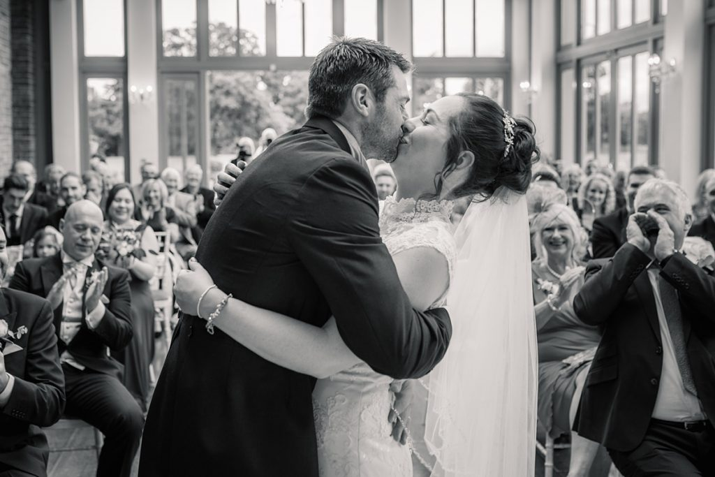 Bride and groom first kiss at Offley Place Wedding, taken by Becky Harley Photography