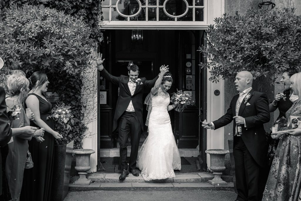 Bride and groom exiting Offley Place Wedding, taken by Becky Harley Photography