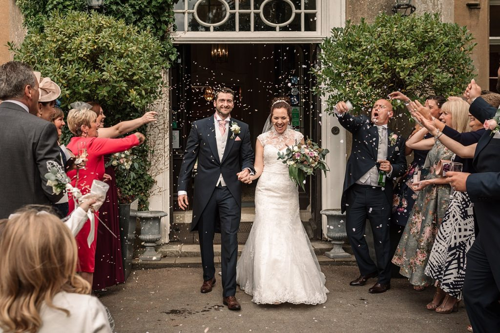Confetti thrown at bride and groom at Offley Place Wedding, taken by Becky Harley Photography