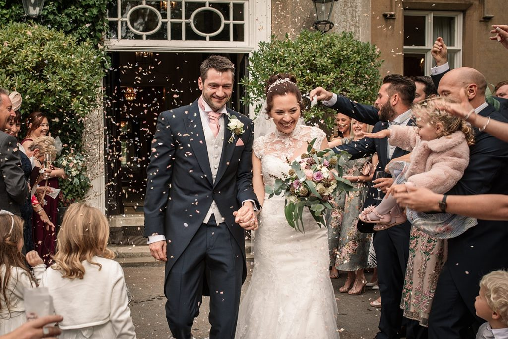 Bride and groom with confetti at Offley Place Wedding, taken by Becky Harley Photography