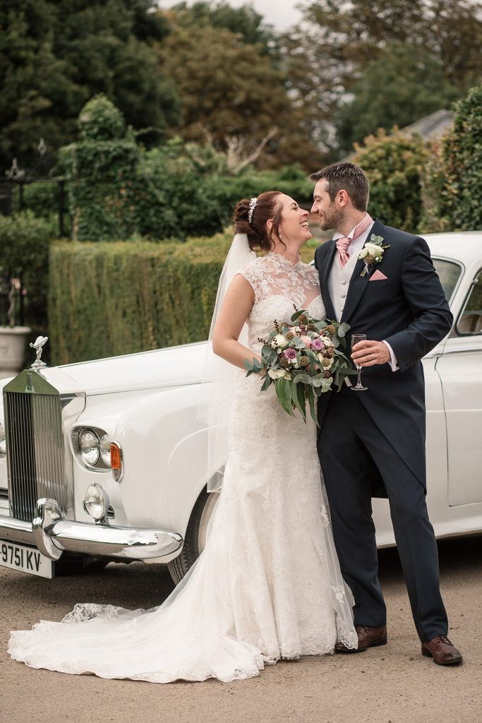 Bride and groom with wedding car at Offley Place Wedding, taken by Becky Harley Photography