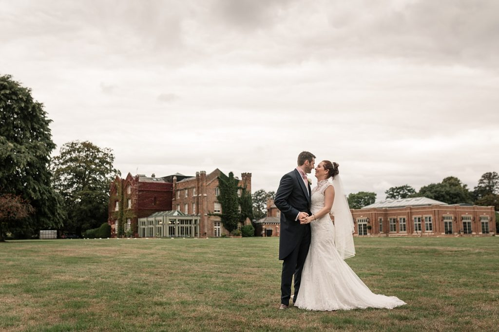Bride and groom with Offley Place in background