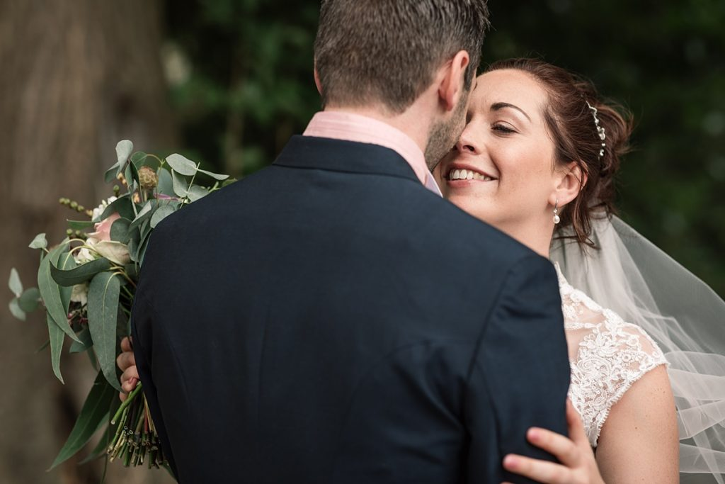 bride and groom embrace at Offley Place Wedding, taken by Becky Harley Photography