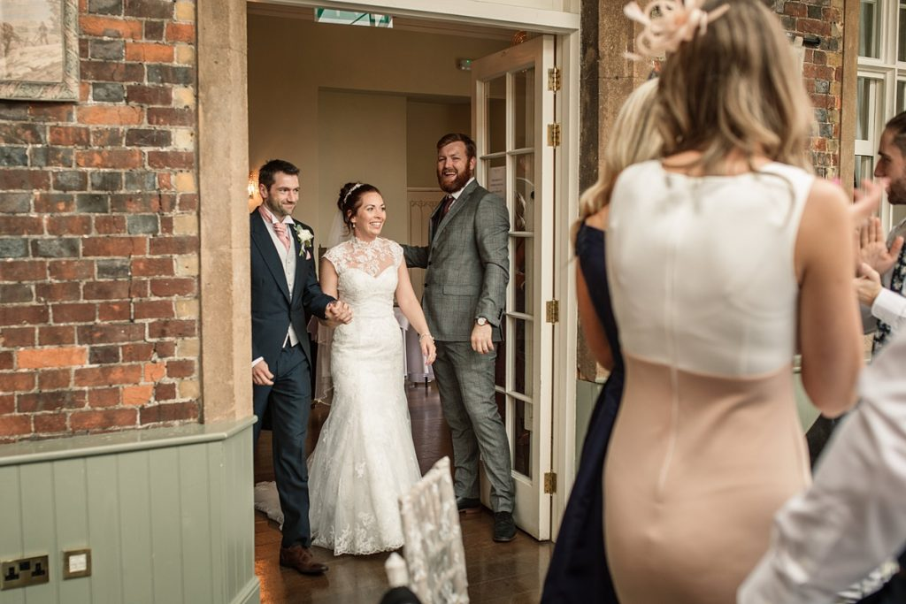 Bride and groom entering the conservatory at Offley Place Wedding, taken by Becky Harley Photography