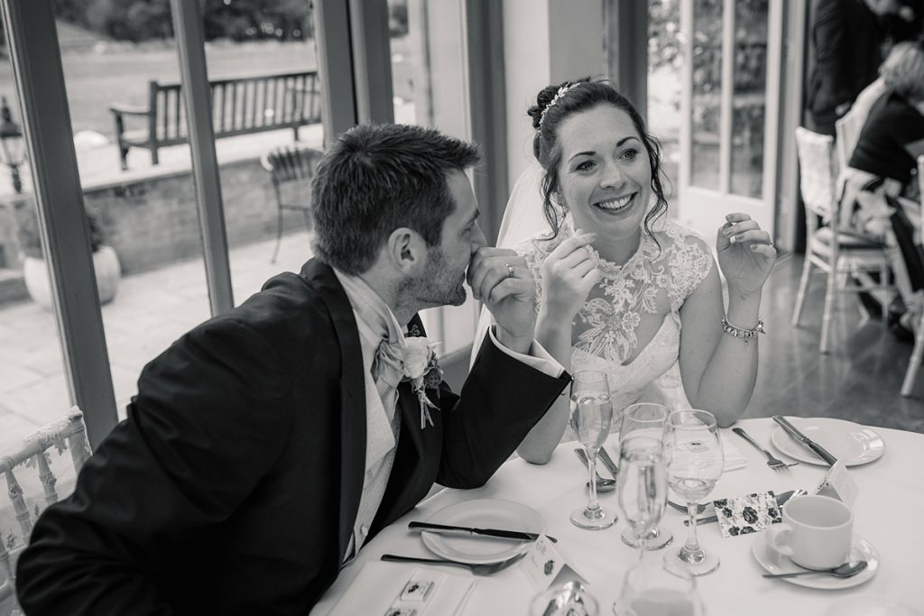 Bride and groom talking at Offley Place Wedding, taken by Becky Harley Photography