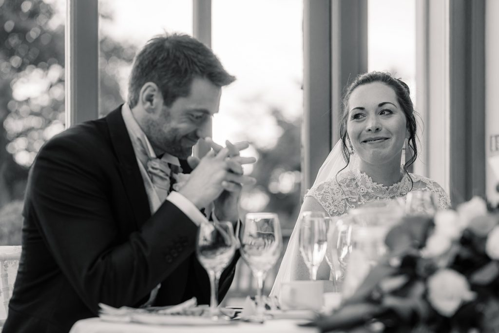 Bride smiling at groom at Offley Place Wedding, taken by Becky Harley Photography
