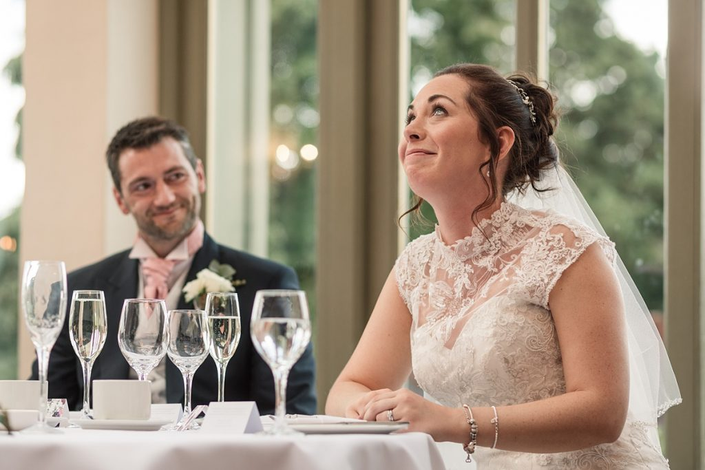 bride reaction to dad's speech at Offley Place Wedding, taken by Becky Harley Photography