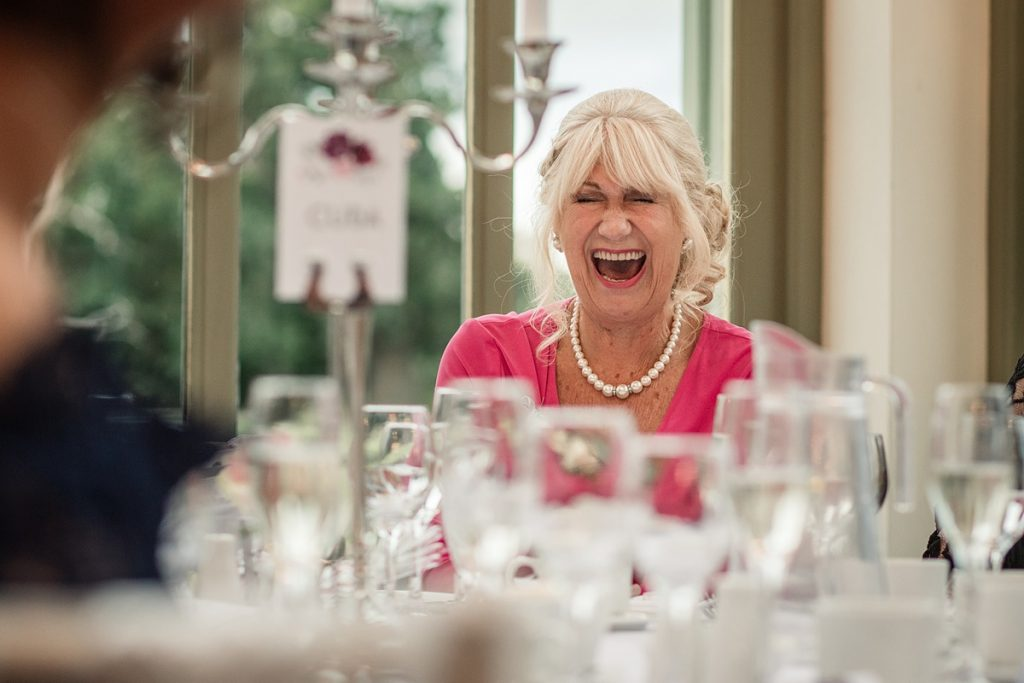 guest reaction to speech at Offley Place Wedding, taken by Becky Harley Photography