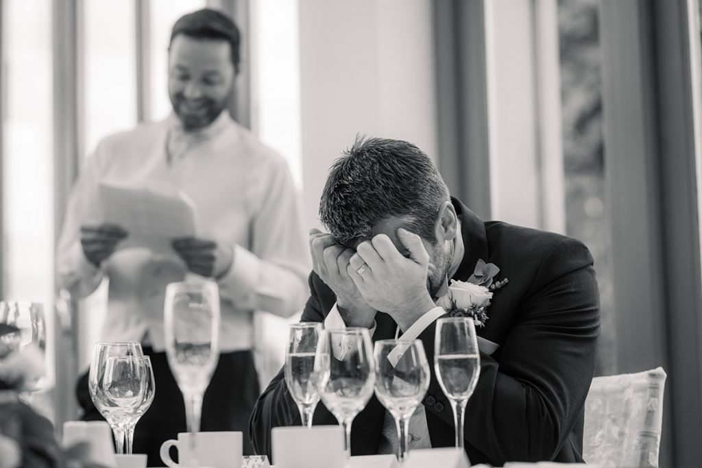 Groom reaction to best man speech at Offley Place Wedding, taken by Becky Harley Photography