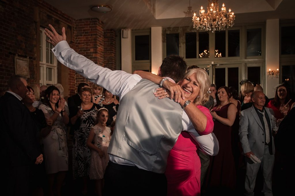 Groom dancing with mum at Offley Place Wedding, taken by Becky Harley Photography