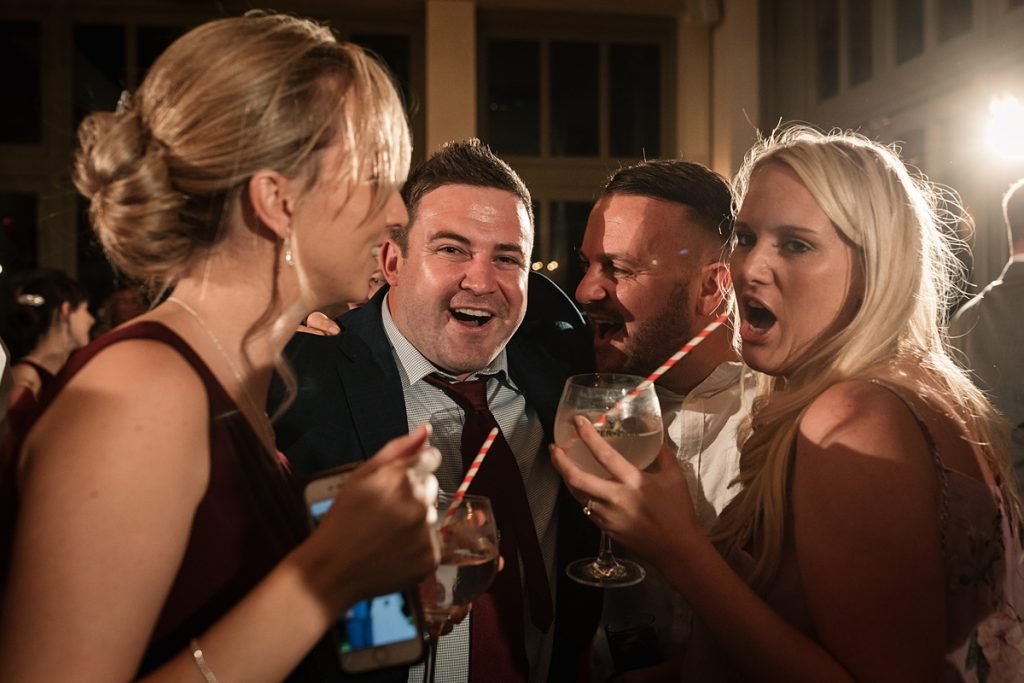 guests celebrating at Offley Place Wedding, taken by Becky Harley Photography
