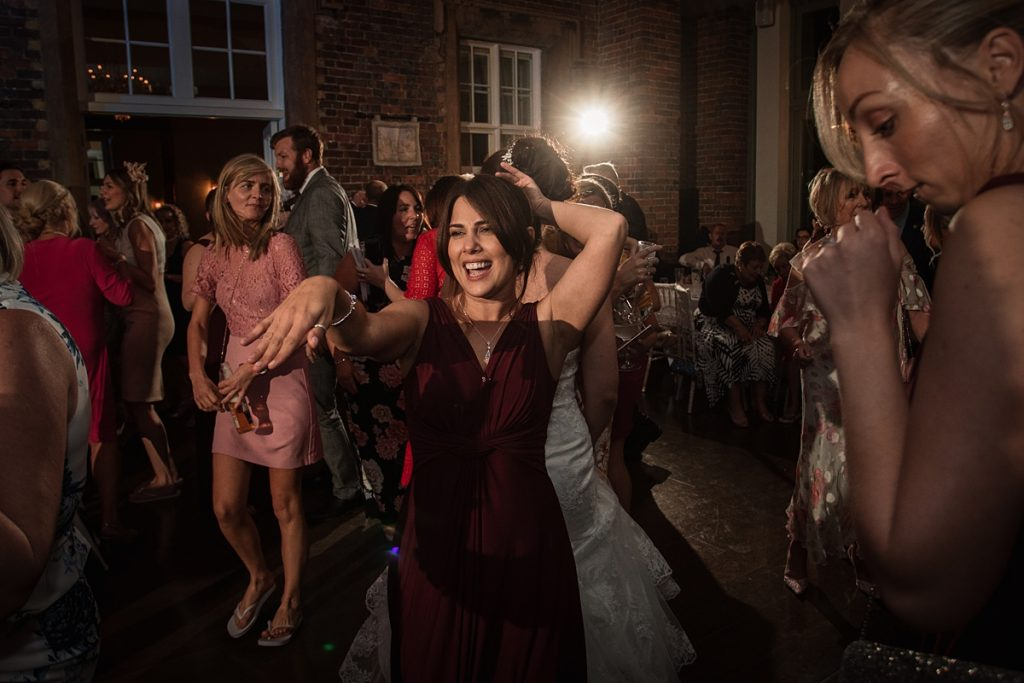 Bridesmaid dancing at Offley Place Wedding, taken by Becky Harley Photography
