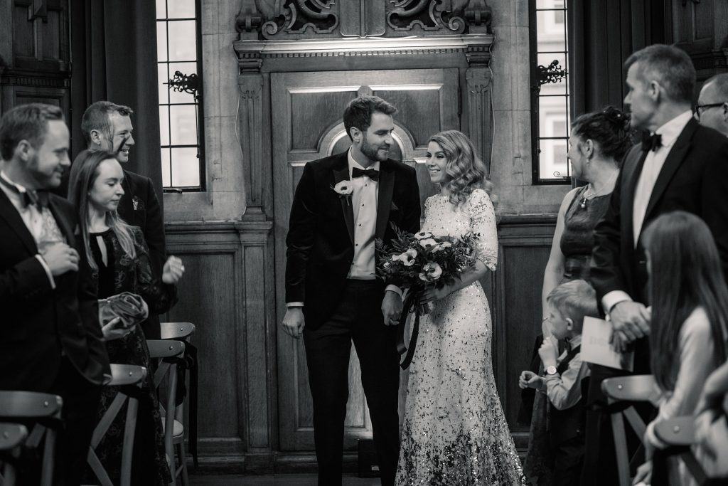 Bride and groom walking down the aisle at Oxford Town Hall wedding taken by Becky Harley Photography