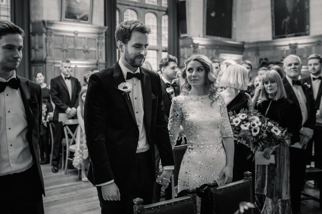 Bride and groom during ceremony at Oxford Town Hall wedding taken by Becky Harley Photography