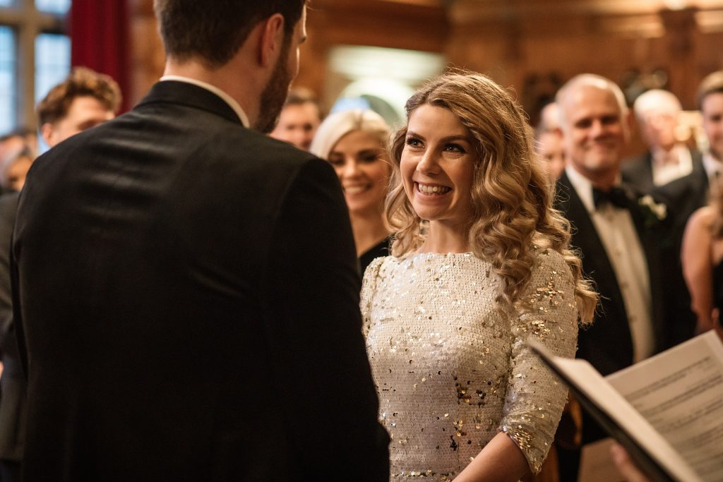 Bride smiling during ceremony at Oxford Town Hall wedding taken by Becky Harley Photography